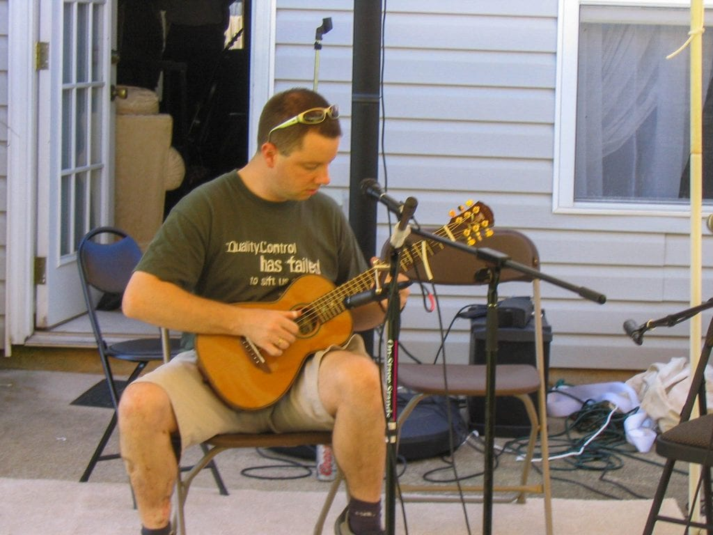 Cams playing a Brook Bovey at the open mic at Little Brother's Acoustic Jam 2004